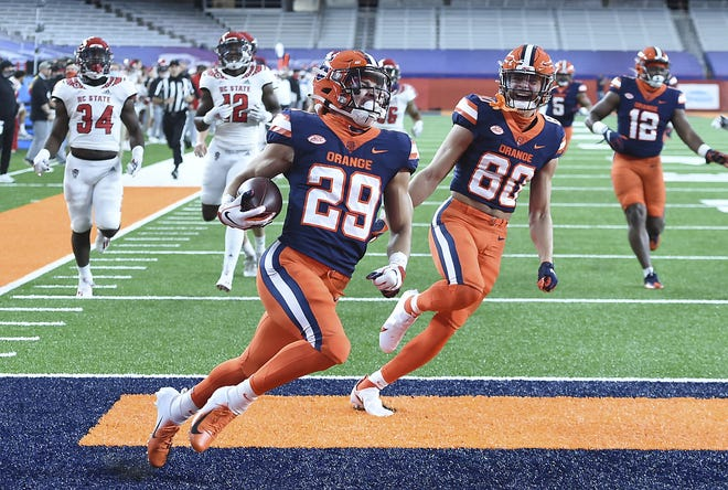 Syracuse wide receiver Trebor Pena (29) runs back a kickoff for a touchdown during the first half of Saturday's game against North Carolina State at the Carrier Dome in Syracuse, New York.