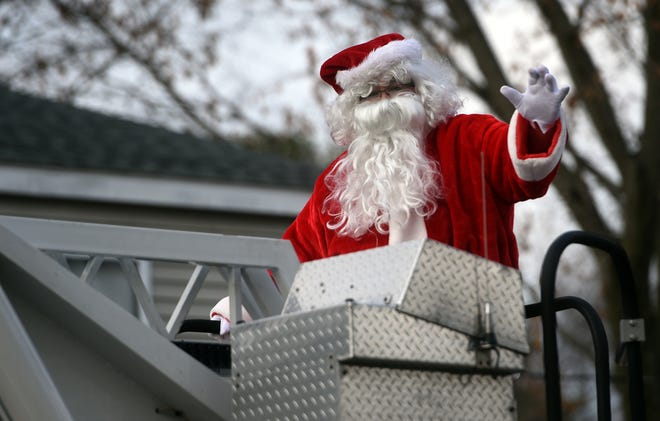 Santa Claus waves to children during a recent visit in South Berwick, Maine. He will be visiting Dover Saturday, Dec. 19.