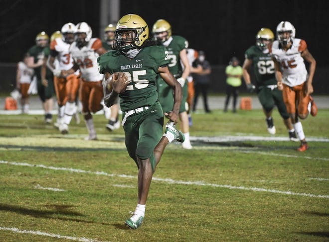 Fleming Island running back Sam Singleton (25) runs for one of four touchdowns in the second half against Atlantic Coast.