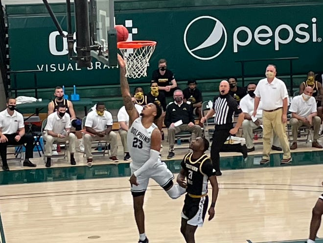 Jacksonville University's Tyreese Davis lays the ball up ahead of  Southern Mississippi's Jay Malone in the first half of Saturday's game at Swisher Gym.
