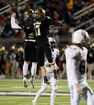 Post's Nathan McDaniel (17) celebrates his touchdown with Slayden Pitttman (5) during the first half of a Class 2A Division 1 playoff game Friday, Nov. 27, 2020, at Pirate Stadium at First United Park. (Mark Rogers/For A-J Media)