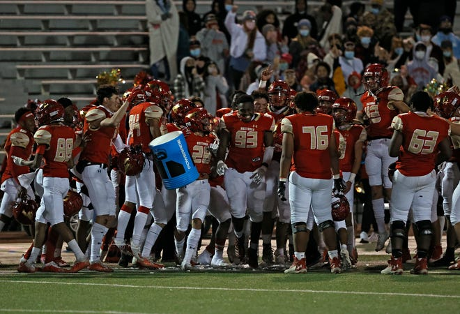 Coronado players celebrate after the game against Monterey, Friday, Nov. 27, 2020, at PlainsCapital Park at Lowrey Field in Lubbock, Texas.