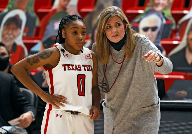 Texas Tech coach Krista Gerlich talks to Chrislyn Carr (0) during a nonconference game Saturday against Houston Baptist at United Supermarkets Arena. Carr finished with a career-high 11 rebounds to go with eight points and three assists in the Lady Raiders 68-51 win.