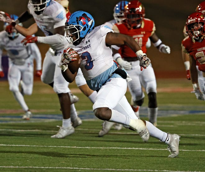 Monterey's Zyion Martin (3) runs with the ball during the game against Coronado, Friday, Nov. 27, 2020, at PlainsCapital Park at Lowrey Field in Lubbock, Texas.