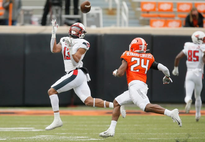 Texas Tech wide receiver Erik Ezukanma, left, catches a 48-yard touchdown pass over Oklahoma State cornerback Jarrick Bernard-Converse (24) during the Red Raiders' 50-44 loss on Nov. 28. Ezukanma is among the Big 12's receiving leaders, but Tech is 87th in the FBS in yards per pass attempt.