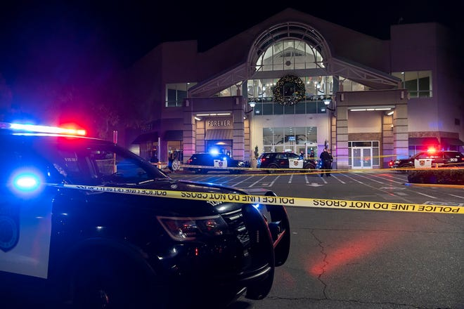 Sacramento police work at the area where two people were killed in a shooting at Arden Fair Mall in Sacramento, Calif., on Friday. The mall was evacuated in the midst of Black Friday, one of the busiest shopping days. Police later said the suspect had fled and there was no active threat to the mall.