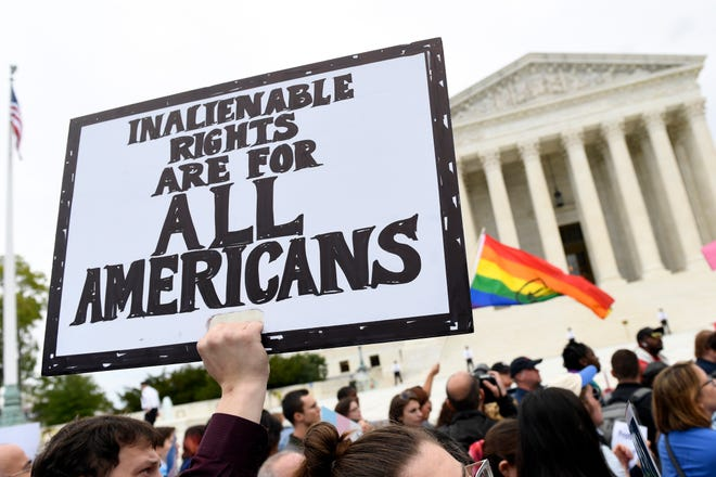 Protesters gather in October 2019 outside the Supreme Court in Washington where the Supreme Court is hearing arguments in the first case of LGBT rights since the retirement of Supreme Court Justice Anthony Kennedy.