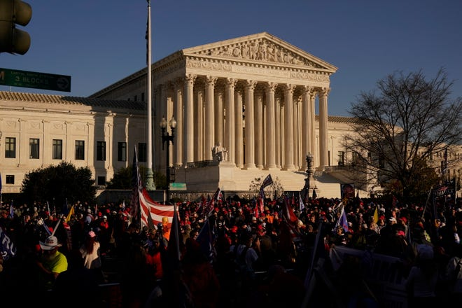 Supporters of President Donald Trump attend a Nov. 14 pro-Trump marches outside the Supreme Court Building in Washington. The Supreme Court is hearing arguments over whether the Trump administration can exclude people in the country illegally from the count used for divvying up congressional seats.