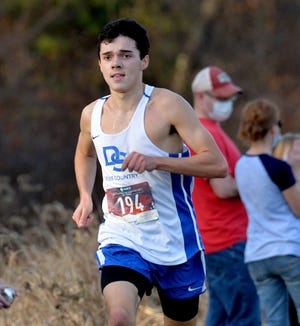 Dover-Sherborn runner Noah Guarini finishes first in a cross country race against Millis on Nov. 7 at Dover-Sherborn.