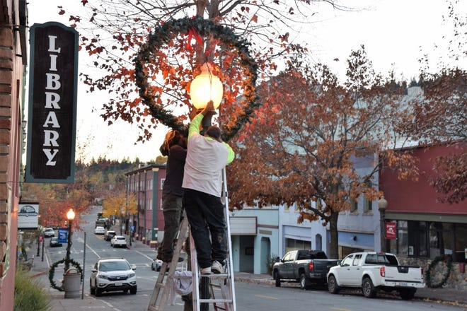 Dunsmuir Councilman Big Dave Keisler with the help of community members worked into the night hanging wreaths and decorating the poles. This year, there will be no holiday events due to the pandemic.