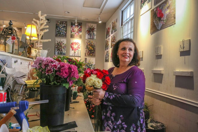 "Cheryl Marsella behind the counter at her Warwick shop, Petals Gift Shop & Florist. Marsella has ramped up her online presence since the pandemic hit. ""Social media's vital,"" she says. ""That's where it's at right now."