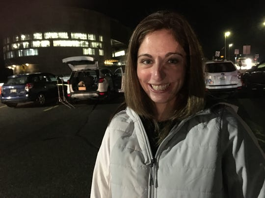 Marie Potter of Coventry waits at CCRI in Warwick for her husband, Capt. Patrick Potter, commander of 160 R.I. National Guard Military Police, who returned Thursday night from 10 months in the Middle East.