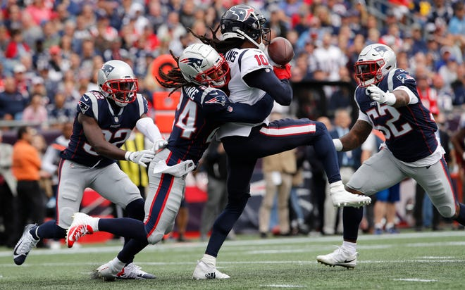 Patriots cornerback Stephon Gilmore prevents a catch by Texans wide receiver DeAndre Hopkins in the second quarter of Sunday's game at Gillette Stadium.
