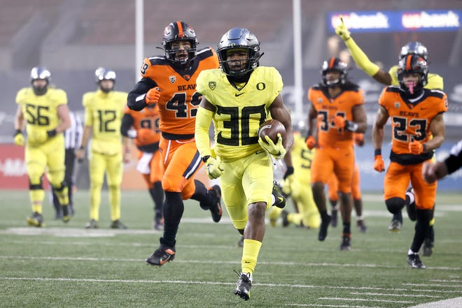 Oregon wide receiver Jaylon Redd (30) runs for a touchdown against Oregon State during the first half of their game at Reser Stadium last month.