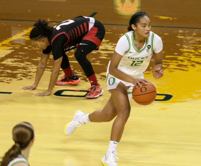 Oregon's Te-Hina Paopao, right, brings the ball down court during Saturday's game against Seattle University.