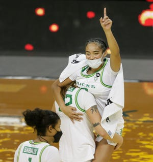 Oregon's Sedona Prince carries teammate Te-Hina Paopao off the court after a win over Seattle University.