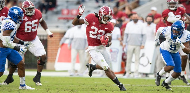 Alabama running back Najee Harris (22) leads the Crimson Tide's high-powered against Auburn in the Iron Bowl on Saturday.