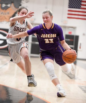 Jackson's Lauren Pallotta drives to the hoop in the first half with pressure from Green's Mallory Oddo.