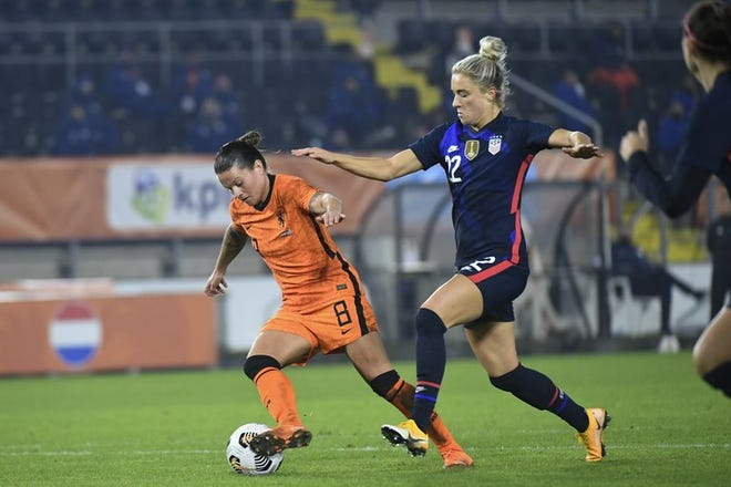 The Netherlands' Sherida Spitse, left, and the United States' Kristie Mewis vie for the ball Friday during an international friendly, won by the US, 2-0, in Breda, Netherlands.