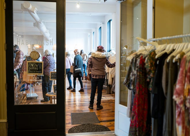 Masked shoppers fill the interior of The Haberdash on Small Business Saturday in Worcester.