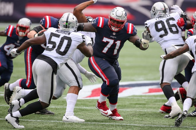 Michael Onwenu (middle) made his presence known on the Patriots offensive line early this season.