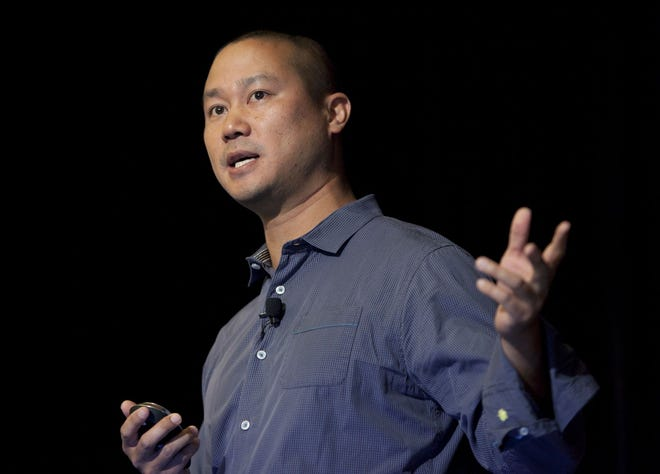 In this 2013 file photo, Tony Hsieh speaks during a Grand Rapids Economic Club luncheon in Grand Rapids, Mich.