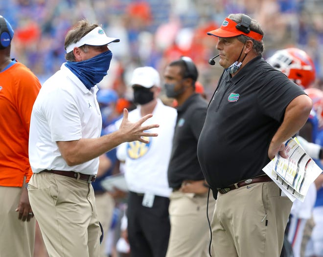 Florida head coach Dan Mullen, left, yells at defensive coordinator Todd Grantham as the defense gives up yardage in the second quarter against the Kentucky Wildcats at Ben Hill Griffin Stadium.