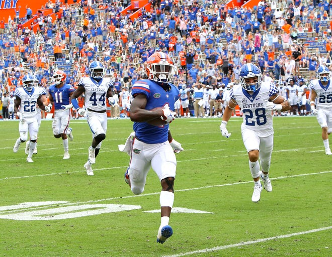 Florida's Kadarius Toney runs a punt back for a touchdown late in the second quarter Saturday against Kentucky at Ben Hill Griffin Stadium.