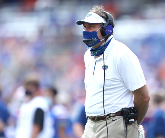 Florida coach Dan Mullen watches his team form the sideline during Saturday's game against Kentucky at Ben Hill Griffin Stadium.