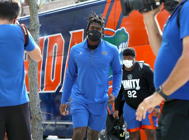 Florida linebacker Brenton Cox walks into the stadium before Saturday's game against the Kentucky Wildcats at Ben Hill Griffin Stadium.