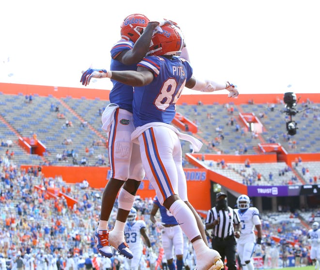 Florida Gators tight end Kyle Pitts (84) and receiver Ladarius Toney (1) celebrate after Pitts scored a touchdown during a football game against the Kentucky Wildcats at Ben Hill Griffin Stadium in Gainesville, Fla. Nov. 28, 2020.   [Brad McClenny/The Gainesville Sun]