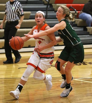 Claymont's Bailey Eddieman drives the ball down court as Malvern's Emma Debo defends in the game Saturday at Claymont High Saturday.