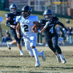 Pueblo South High School's George Longoria, left, takes the Colts first offensive play of the game for a 58-yard touchdown against Roosevelt on Saturday at Roosevelt High School. (Chieftain photo/Austin White]