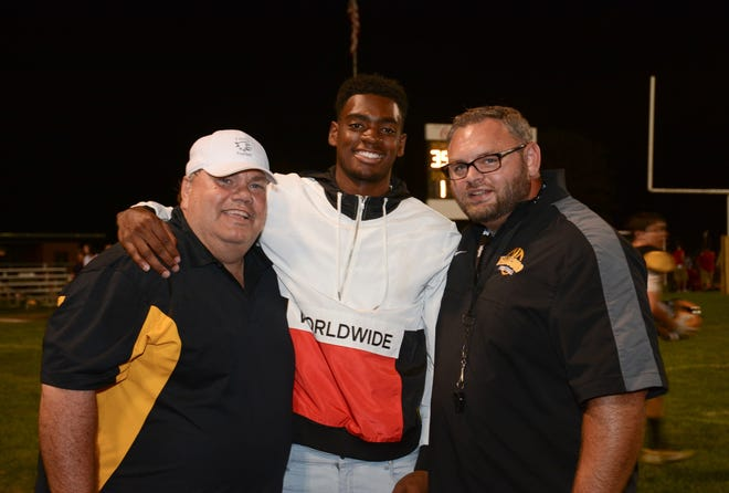 Ricky Vaughn (left), a longtime high school football coach in Ohio, died Nov. 25 from complications of the COVID-19 coronavirus. He was 58. Here he is pictured with Seth Dawkins, a 2016 Franklin Heights graduate who went on to play at Louisville, and Tennyson Varney, a former Franklin Heights head coach who now coaches at Hamilton Township. Vaughn was an assistant on Varney's staff at Franklin Heights from 2014-16 and at Grove City from 2017-18.