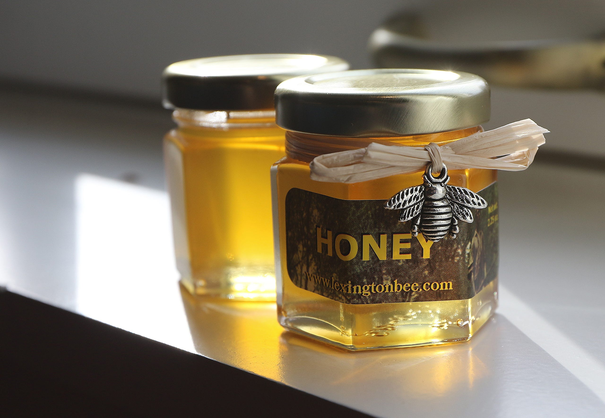 Some of the Lexington Bee Company honey for sale sat on the window sill at the Lexington Visitors Center, Nov. 28.