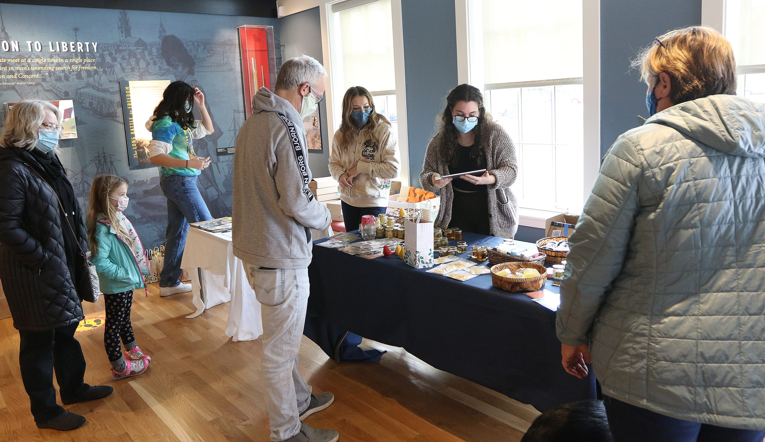 """The Lexington Visitors Center was home to members of the Lexington High School """"Bee Club"""" as they volunteered with the Lexington Bee Company on Small Business Saturday in Lexington, Nov. 28."""