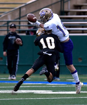 Abilene High defensive back Noah Hatcher breaks up a pass meant for Midland High wide receiver Luke Manning during the Nov. 27 game at Shotwell Stadium.  Abilene High won the District 2-6A game 56-14. Hatcher was named the district's defensive newcomer of the year.