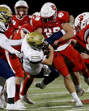 Lloyd Memorial High School quarterback Jacob Davidson is brought down by Beechwood linebacker Avery Courtney during their Class 2A tournament game at Beechwood Friday, Nov. 27, 2020.