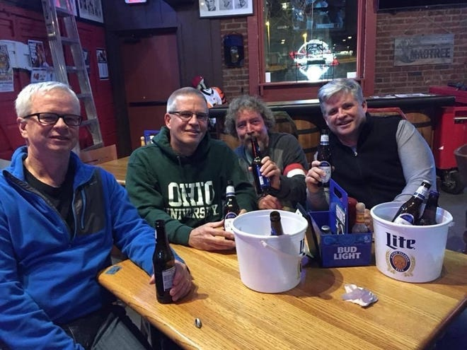 """From the left: The Enquirer sports crew of John Fay, Tom Groeschen, Mike """"Flea"""" Ball and Rory Glynn at Kitty's Sports Grill on 3rd Street Downtown."""