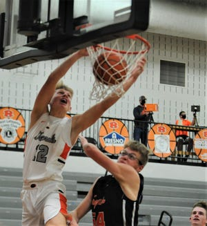 Ridgewood's Kole Hamilton throws down a dunk in Friday's 75-6 win over Newcomerstown.