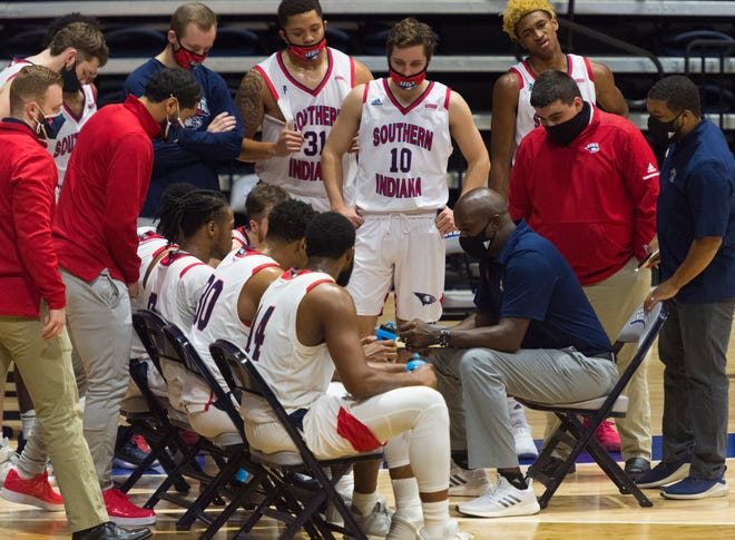 USI's Head Coach Stan Gouard  gives direction as the University of Southern Indiana Screaming Eagles play the Rockhurst Hawks at the Screaming Eagles Arena in Evansville, Ind., Friday afternoon, Nov. 27, 2020.