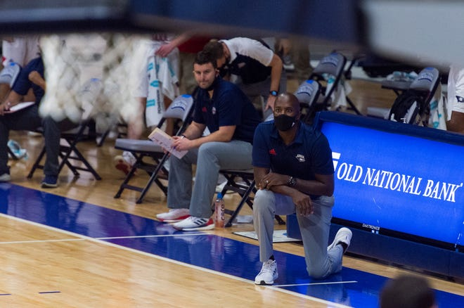 USI's Head Coach Stan Gouard coaches his first game as the University of Southern Indiana Screaming Eagles play the Rockhurst Hawks at the Screaming Eagles Arena in Evansville, Ind., Friday afternoon, Nov. 27, 2020.