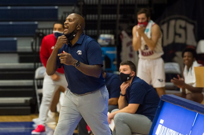 USI's Head Coach Stan Gouard calls a play as the University of Southern Indiana Screaming Eagles play the Rockhurst Hawks at the Screaming Eagles Arena in Evansville, Ind., Friday afternoon, Nov. 27, 2020.