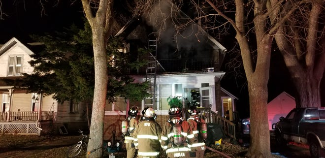 Firefighters work Saturday morning to put out a fire at a duplex on East Jefferson Street in Waupun.