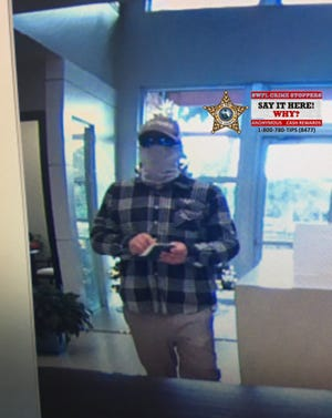Authorities are asking for the public's help identifying a man who robbed MidWestOne Bank in Fort Myers on Nov. 27, 2020.