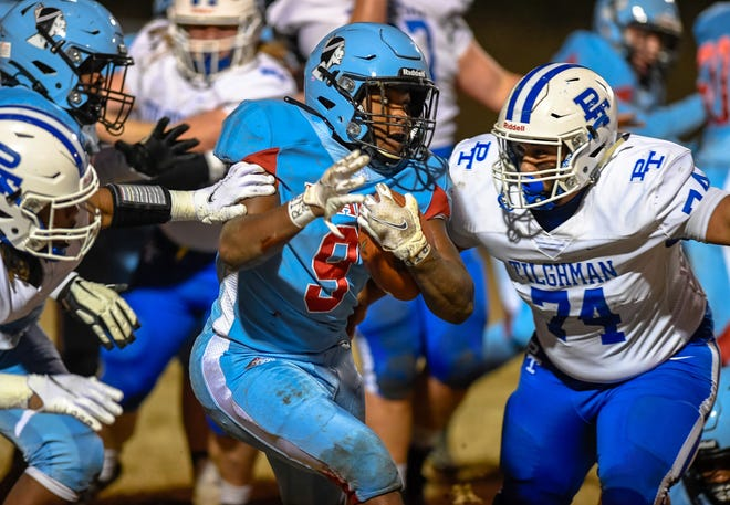 Union County's Corithian Seales-Portee (9) bulls his way though the Tornado defense as the Union County Braves host the Paducah Tilghman Blue Tornados in the second round of the 3-A playoffs Friday, November 27, 2020.