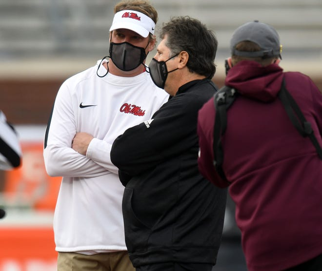Mississippi head coach Lane Kiffin and Mississippi State Bulldogs head coach Mike Leach talk before the game at Vaught-Hemingway Stadium in Oxford, Miss. on Saturday, Nov. 28, 2020.  (©Bruce Newman)