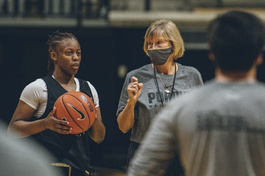 Purdue junior guard Brooke Moore and coach Sharon Versyp