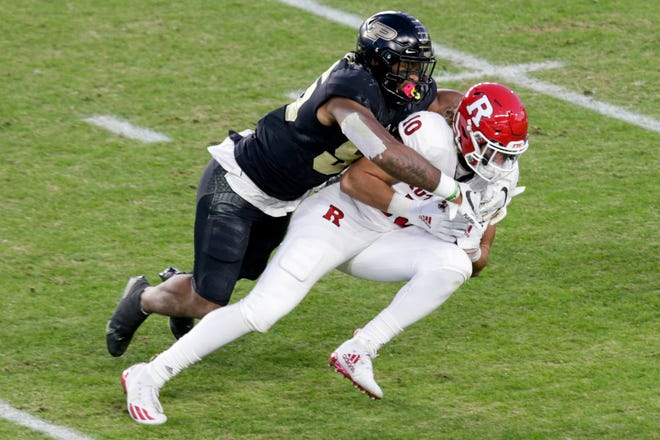 Purdue linebacker Derrick Barnes (55) tackles Rutgers tight end Matt Alaimo (10) during the second quarter of an NCAA college football game, Saturday, Nov. 28, 2020 at Ross-Ade Stadium in West Lafayette.