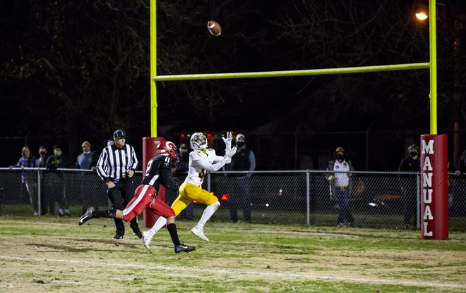 St. Xavier wide receiver Michael Duddy (89) reaches out to catch the game winning touchdown in the Tigers' hard-fought, 10-6 victory against Manual in the second round of the Class 6A playoffs on Friday, Nov. 27, 2020.